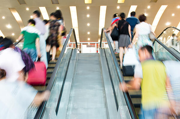 People travelling on escalator in shopping center